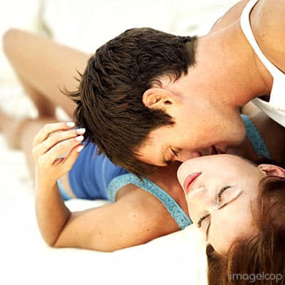 man woman kiss bed 400a061807