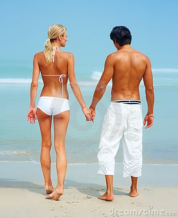 rear view of a cute couple holding hands thumb8587103