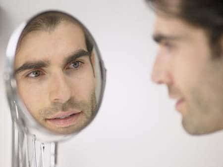 man looking in mirror